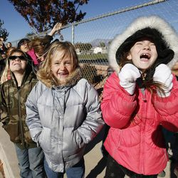 Hurricane Elementary students yell for Santa as Santa Flight volunteers bearing Christmas gifts land in Hurricane on Wednesday, Dec. 7, 2016. Pilots with the Utah Wing of Angel Flight West filled 16 aircraft with 7,000 pounds toys, school supplies, books, backpacks and warm clothing for the Title I schoolchildren. The items were gathered by 16 Boy Scouts as part of their Eagle Scout service project. Since the first Santa Flight in 2000, members of the Utah Wing have worked with their local communities to gather needed supplies and toys, and deliver them to Title I schools in rural communities throughout Utah.