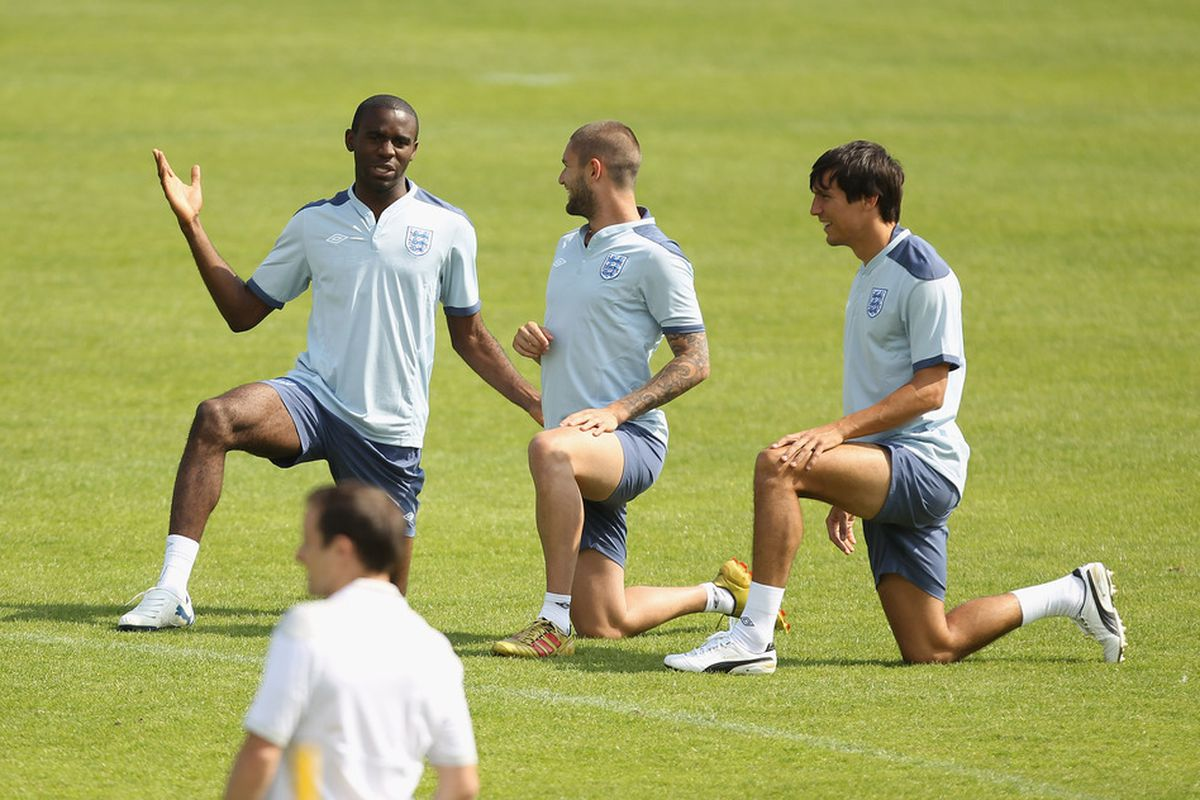 FREDERICIA, DENMARK - JUNE 11:  Fabrice Muamba (L), Henri Lansbury (C) and Jack Cork (R) during the England under 21's training session at Monjasa Park stadium on June 11, 2011 in Fredericia, Denmark.  (Photo by Ian Walton/Getty Images)