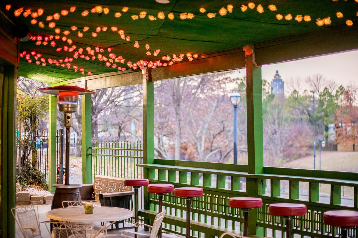The back covered patio with string lights on the ceiling overlooking the Freedom Park Trail