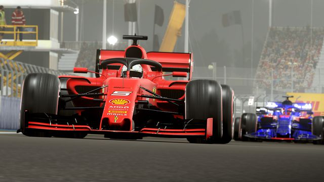 Formula 1 cars approaching the viewer at pavement level in F1 2019 at Abu Dhabi's Yas Marina circuit