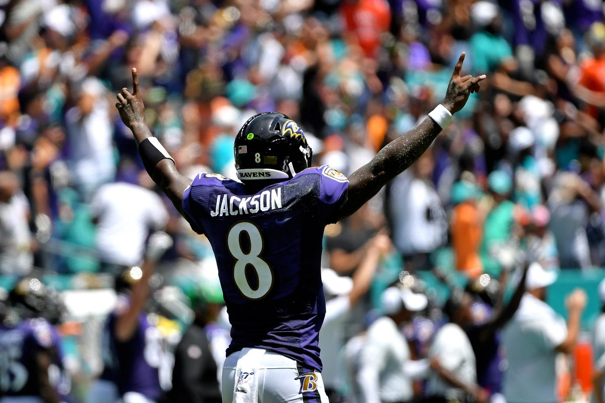 Baltimore Ravens quarterback Lamar Jackson celebrates after throwing a touchdown pass against the Miami Dolphins during the first half at Hard Rock Stadium.