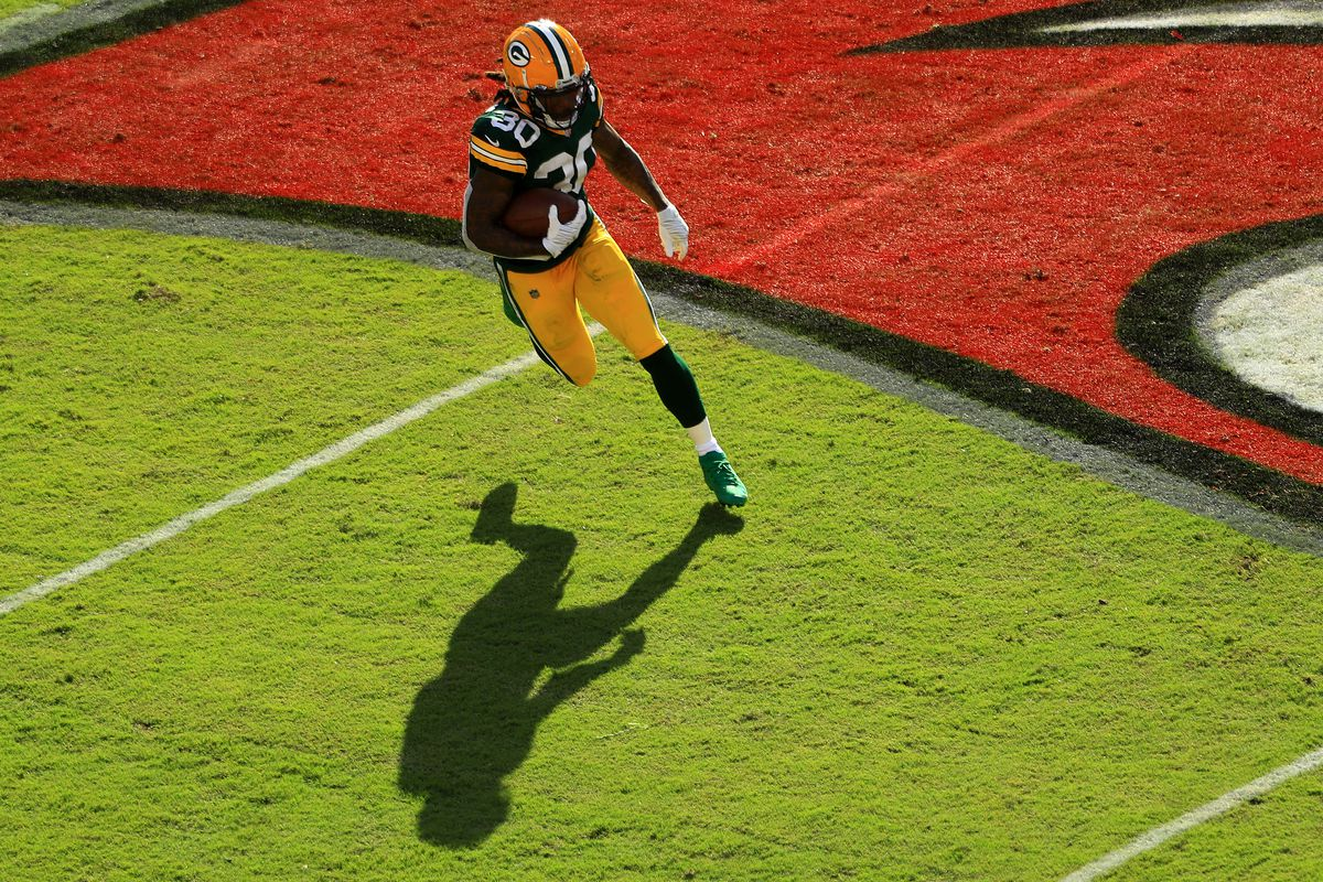 Jamaal Williams #30 of the Green Bay Packers runs against the Tampa Bay Buccaneers during the first quarter at Raymond James Stadium on October 18, 2020 in Tampa, Florida.