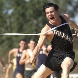 """Jack O'Connell  stars as Olympian and war hero Louis Zamperini in """"Unbroken"""", an epic drama that follows the incredible life of Zamperini who, along with two other crewmen, survived in a raft for 47 days after a near-fatal plane crash in WWII — only to be caught by the Japanese Navy and sent to a prisoner-of-war camp."""