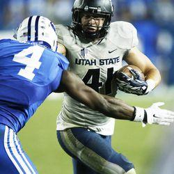 Utah State Aggies linebacker Nick Vigil (41) runs against BYU in Provo Saturday, Oct. 4, 2014. USU won 35-20.