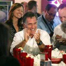 In this Monday, June 20, 2011, file photo, Republican presidential candidate Mitt Romney, center, smiles as he meets with small business owners during a campaign stop in Aurora, Colo. Small business is almost always an issue in presidential campaigns, but this year, it may well be the biggest. The Republican Party has been talking about small business for much of this year, and making voter concerns like taxes and health care small business issues and The Obama campaign have fought back with their own campaign stops and appearances that tout how much the president has done for small business.