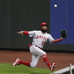 Los Angeles Angels right fielder Jo Adell tries to catch a deep fly ball from Seattle Mariners' Evan White during the seventh inning of a baseball game in Seattle on Aug. 5, 2020.