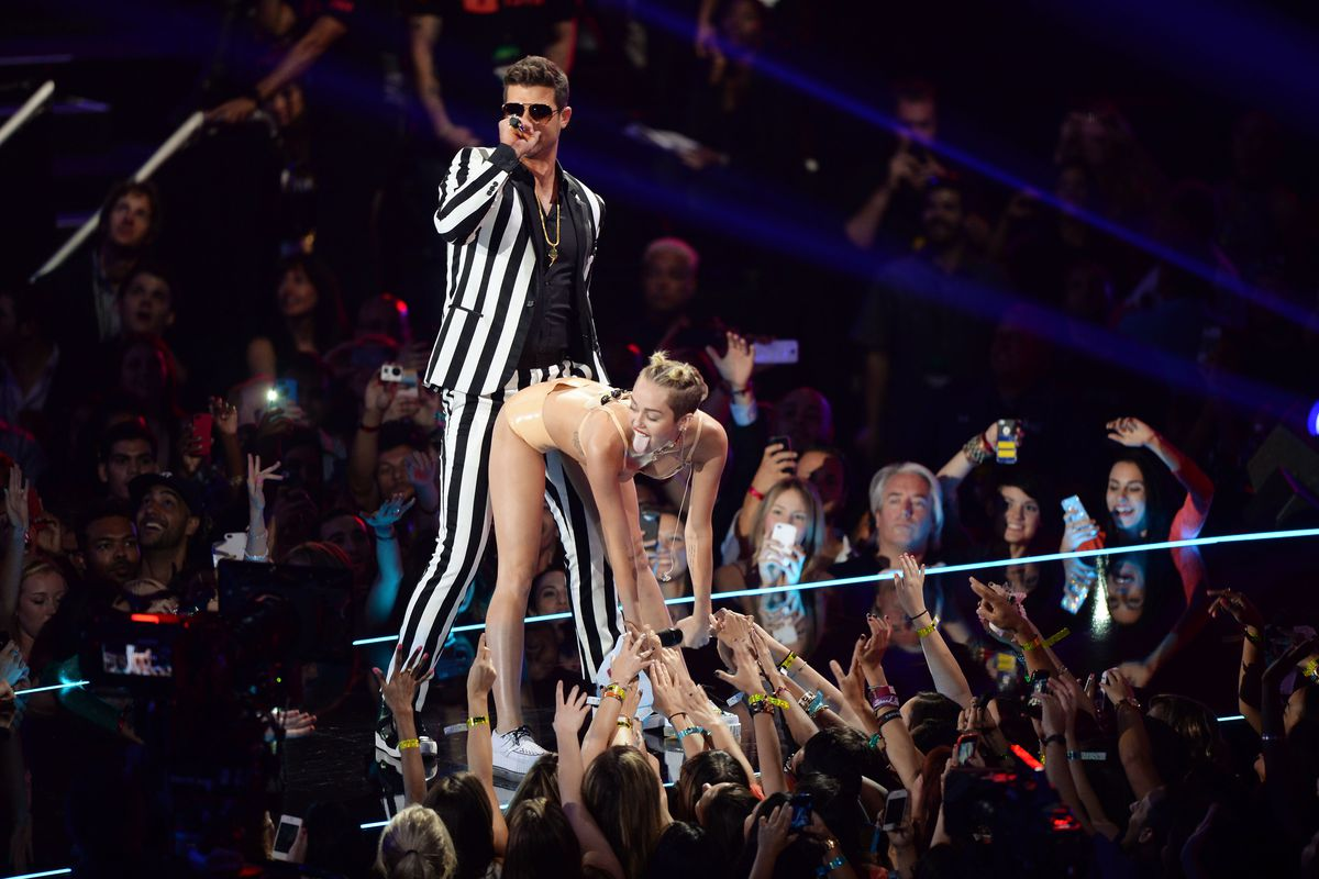 Robin Thicke and Miley Cyrus perform onstage during the 2013 MTV Video Music Awards.