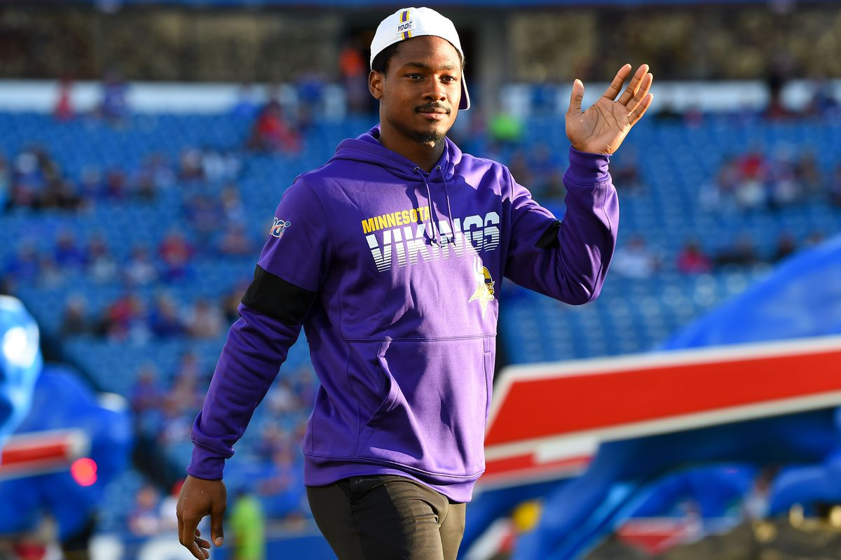 Minnesota Vikings wide receiver Stefon Diggs waves to the crowd while walking on the field prior to the game against the Buffalo Bills at New Era Field.