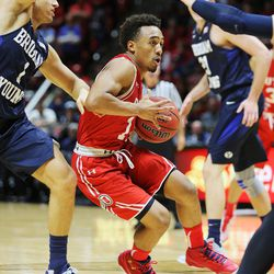 Utah Utes guard Brandon Taylor (11) drives into the lane as Utah and BYU play in the Huntsman Center in Salt Lake City Wednesday, Dec. 2, 2015. Utah won 83-75.