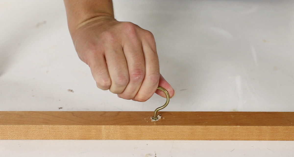 Piloting a hole using a drywall screw