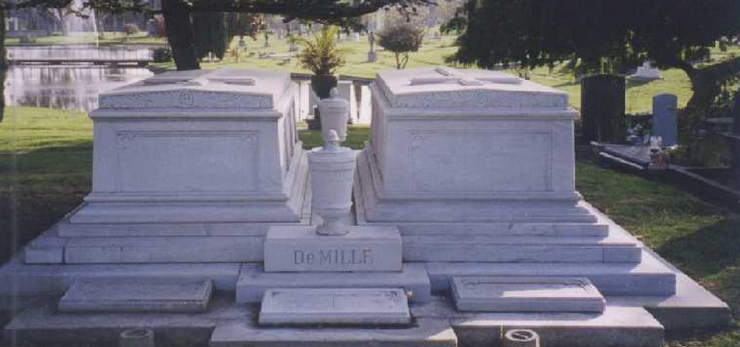 A group of gravestones in the Hollywood Forever cemetery. The words in the center of the group of gravestones read DeMille