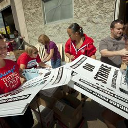 Members of the Chicago Teachers Union distribute strike signage at the Chicago Teachers Union strike headquarters on Saturday, Sept. 8, 2012 in Chicago. The union has vowed to strike on Monday, Sept. 10, 2012, should it fail to reach an agreement over teachers' contracts with Chicago Public Schools by  that date.