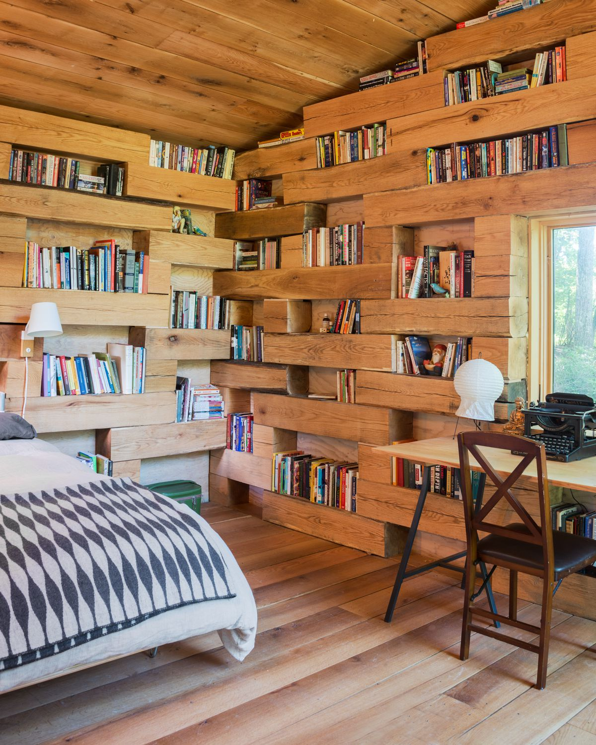 More than half of the wood-paneled interior is covered with bookshelves.