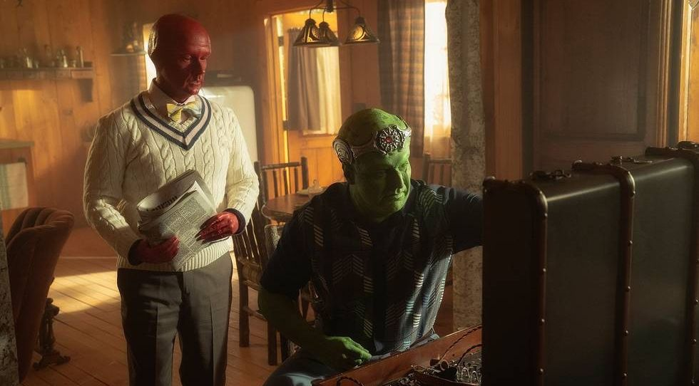 A red-skinned alien and a green-skinned alien fiddle with a suitcase full of outdated-looking technology in season 3 of Doom Patrol