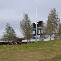 View of scoreboard from right-center field; trees are planted on what will be the hitters' background