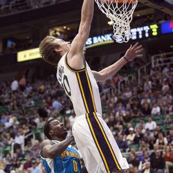 Utah's Gordon Hayward drives to the basket ahead of New Orleans' Al-Farouq for a lay-up as the Utah Jazz and the New Orleans Hornets play Friday, April 5, 2013 at Energy Solutions Arena in Salt Lake City. Hayward is being asked to be a leader on this year's very young Utah Jazz squad.