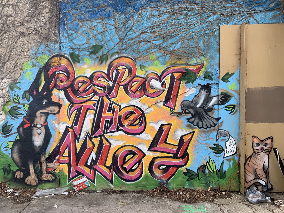 """This """"respect the alley"""" mural by Max Villarreal was meant to send a message: Take care of the neighborhood."""