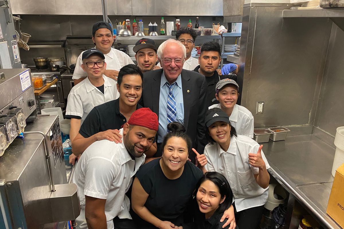 Bernie Sanders poses for pictures with Ayara Thai staff