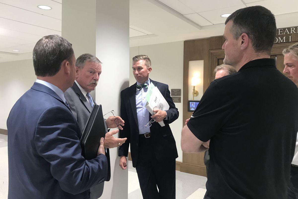 Rep. Ryan Williams (center)  speaks with law enforcement, security, and teacher group representatives after his bill to arm teachers passed Wednesday in a House education subcommittee.