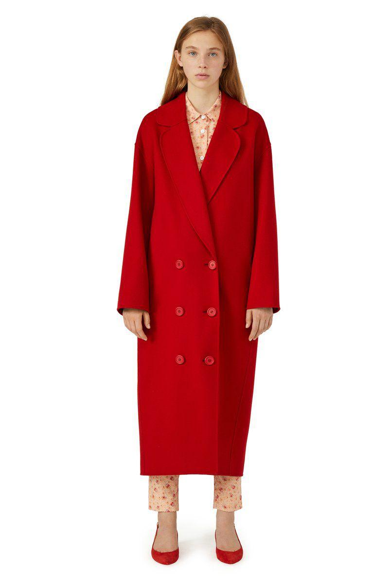 A model in a long red coat