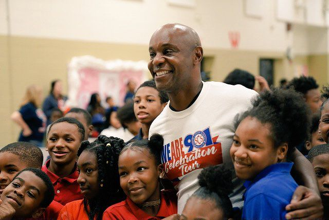 Superintendent Dorsey Hopson with students at A.B. Hill Elementary School in Memphis celebrating academic progress.