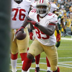 San Francisco 49ers' Vernon Davis (85) reacts after catching a touchdown pass during the second half of an NFL football game against the Green Bay Packers Sunday, Sept. 9, 2012, in Green Bay, Wis. The 49ers won 30-22.