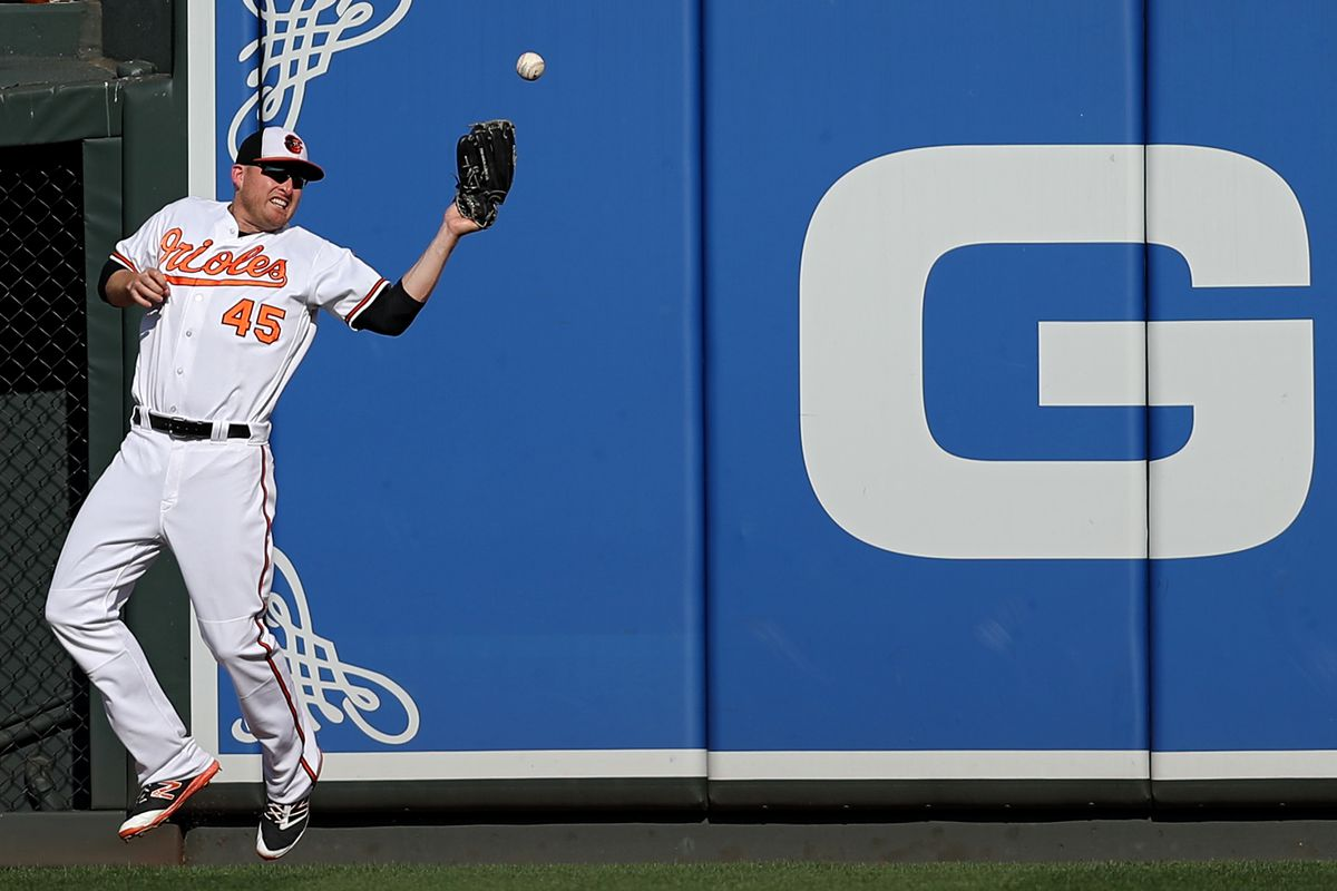 Mark Trumbo fails to catch a ball against the Yankees.