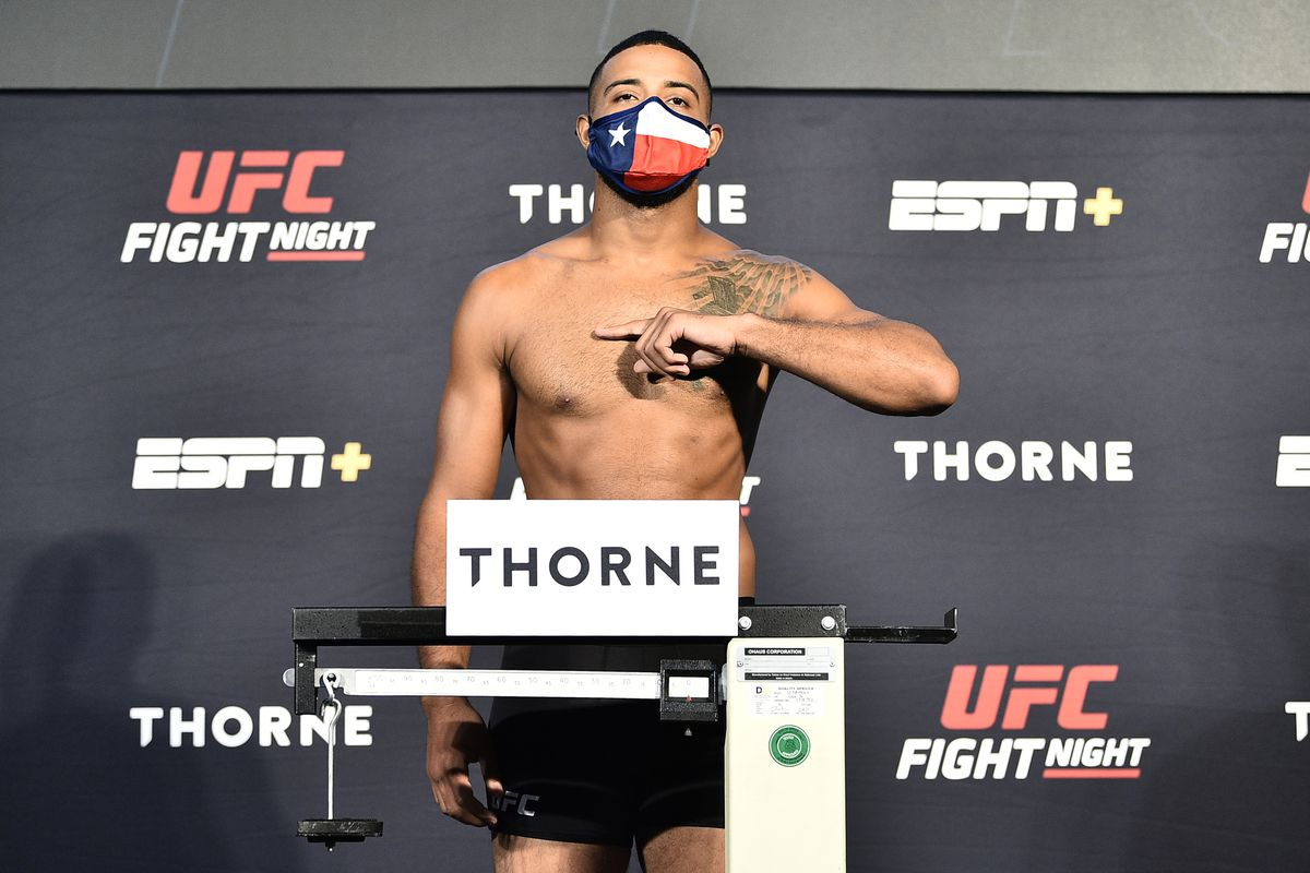 Trevin Giles poses on the scale during the UFC Fight Night weigh-in at UFC APEX on July 31, 2020 in Las Vegas, Nevada.