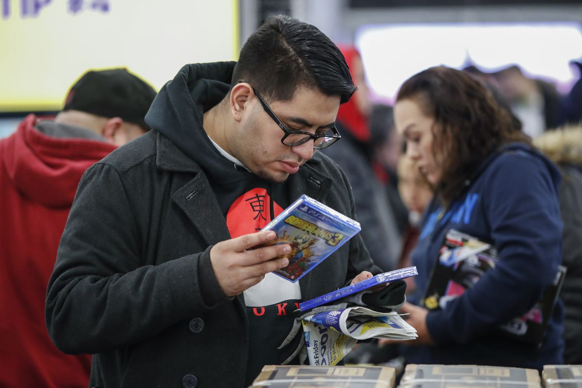 A shopper looks at video games as he shops at a Best Buy Inc. store on November 28, 2019 in Chicago, Illinois.
