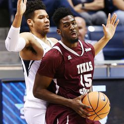 Brigham Young Cougars forward Yoeli Childs (23) defends Texas Southern Tigers forward Marquis Salmon (15) as BYU and Texas Southern play an NCAA basketball game in Provo at the Marriott Center on Saturday, Dec. 23, 2017.