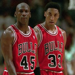 Chicago Bulls' Michael Jordan (45) and Scottie Pippen return to the floor after a time-out in the fourth quarter against the Indiana Pacers Sunday, March 19, 1995. The Pacers defeated the Bulls in overtime103-96 in Jordan's first game back from his 18-month retirement. (AP Photo/Michael Conroy)