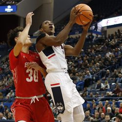 UConn's Christian Vital (1) drives to the basket for a layup.