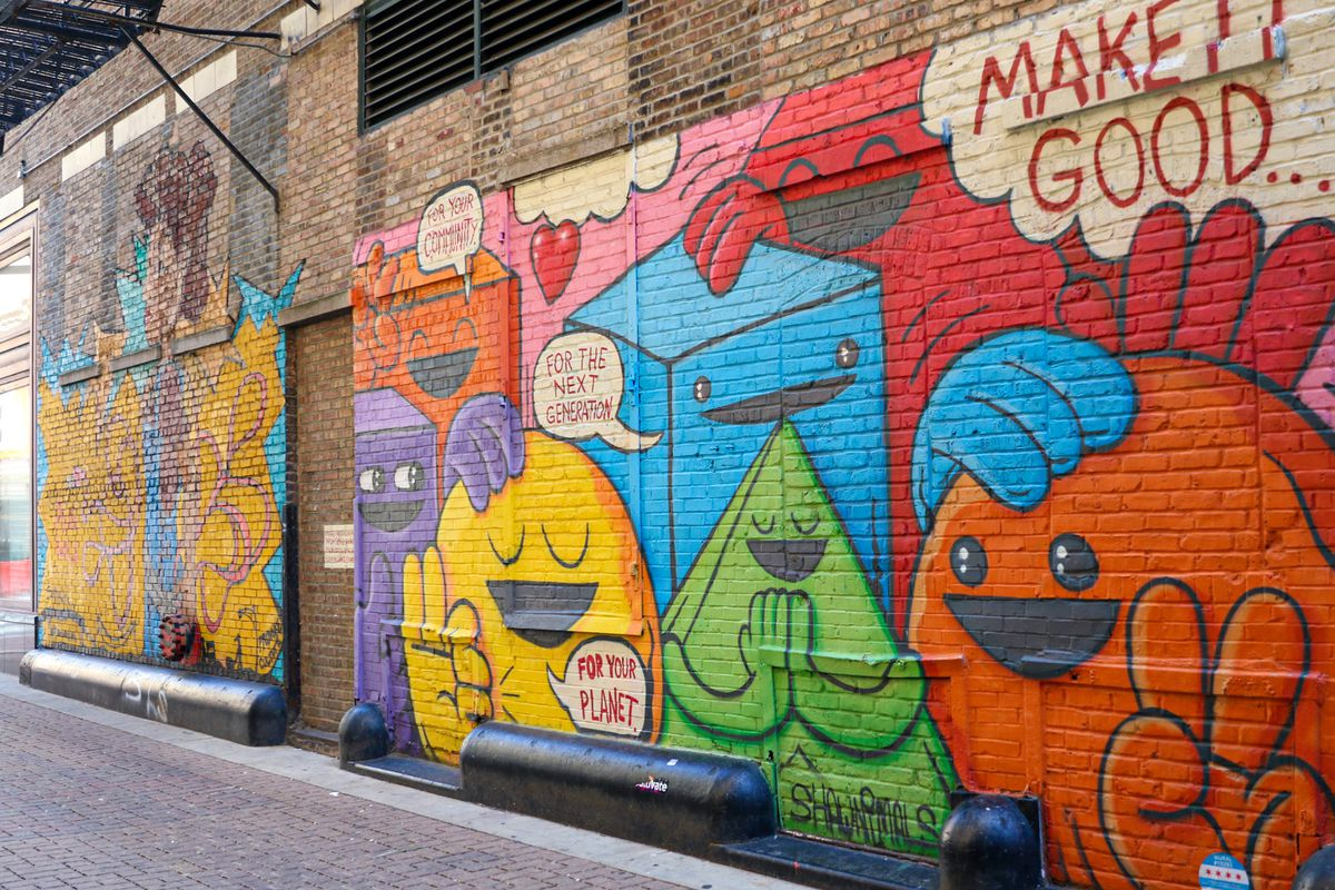 """""""Power to the People"""" by Sam Kirk and """"Make it Good"""" by Shawnimals are murals hidden in the alley at Couch Place between Dearborn and State Street behind the James M. Nederlander Theatre. 