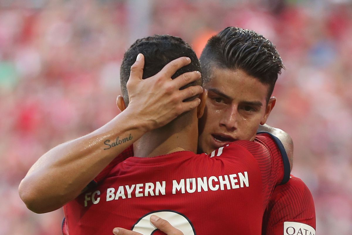 MUNICH, GERMANY - SEPTEMBER 15: James Rodriguez (R) of FC Bayern Muenchen celebrates his goal with teammate Thiagoduring the Bundesliga match between FC Bayern Muenchen and Bayer 04 Leverkusen at Allianz Arena on September 15, 2018 in Munich, Germany.