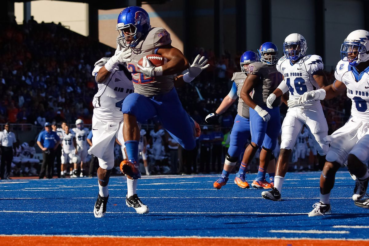 BOISE, ID - OCTOBER 22:  Doug Martin #22 of the Boise State Broncos leaps into the end zone for a touchdown against the Air Force Falcons at Bronco Stadium on October 22, 2011 in Boise, Idaho.  (Photo by Otto Kitsinger III/Getty Images)
