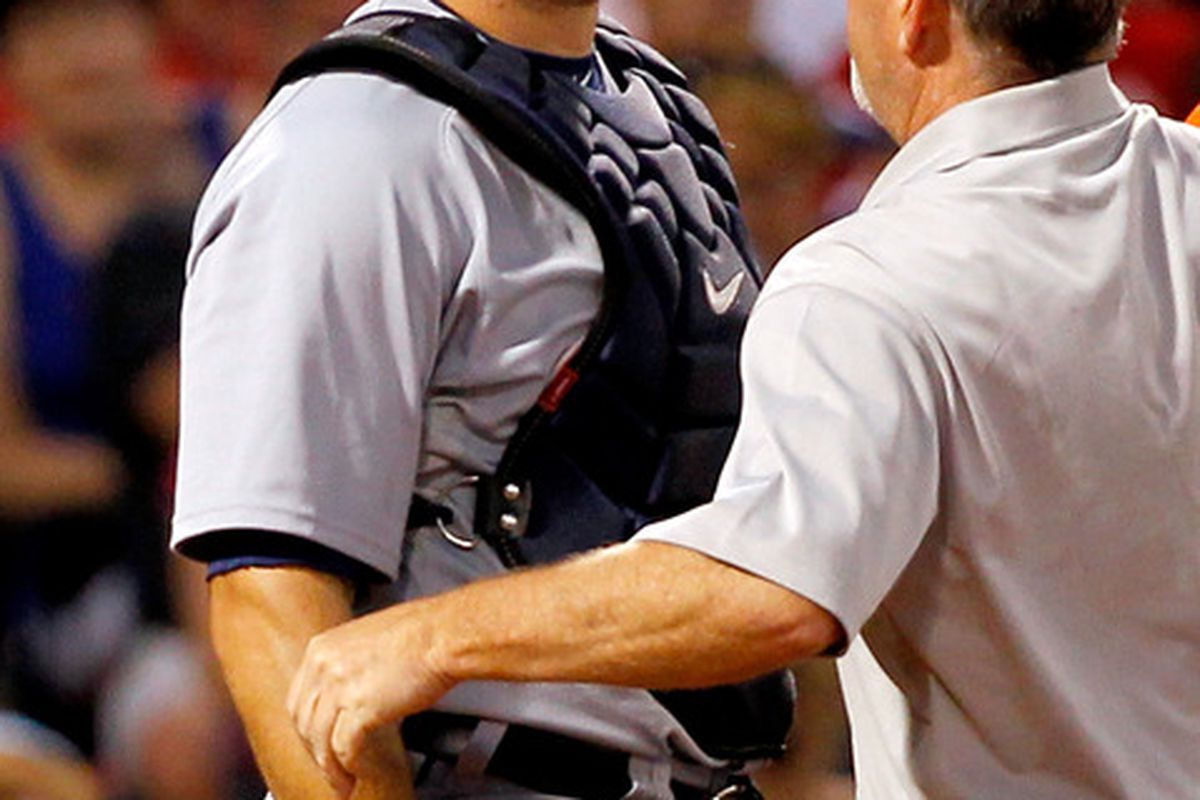 Alex Avila #13 of the Detroit Tigers is attended to after he was struck in the mask by a batted ball in the third inning at Fenway Park May 31, 2012  in Boston, Massachusetts. Avila left the game. (Photo by Jim Rogash/Getty Images)