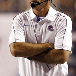 Head coach of the Boise State Broncos watches during NCAA football game against BYU in Boise, Thursday, Sept. 20, 2012.