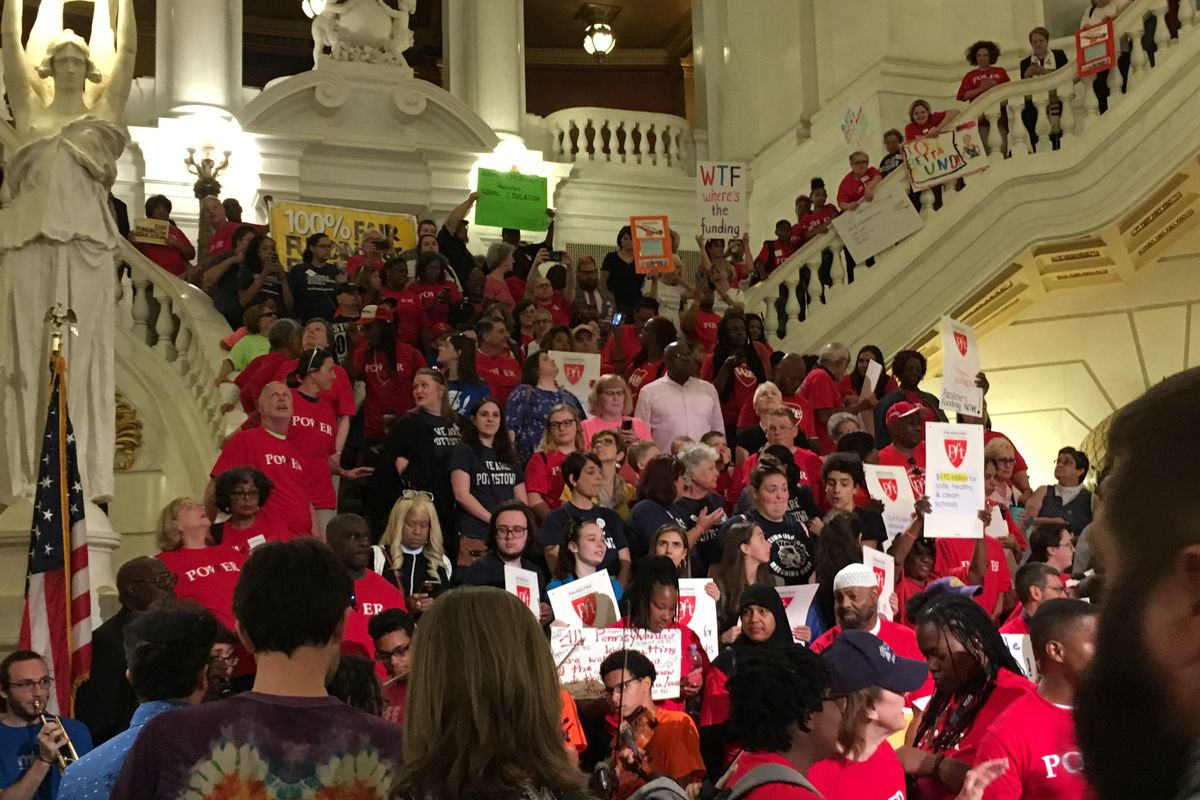 Rally-goers gather on the steps in the Capitol Rotunda on Wednesday to demand fair school funding.