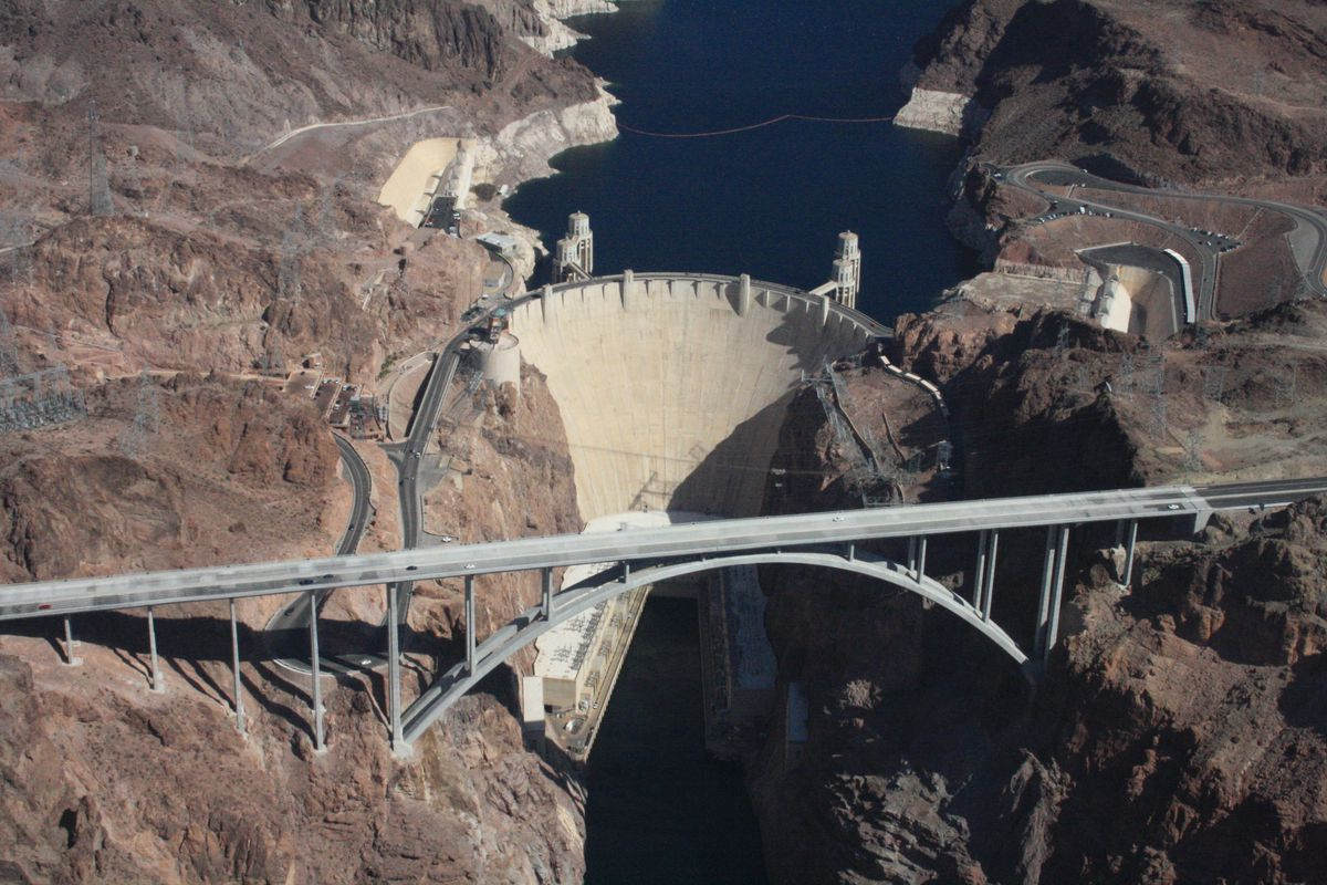 The Hoover Dam from the air. Colorado river and Lake Mead. Significant water level decline is indicated by the white high water line.