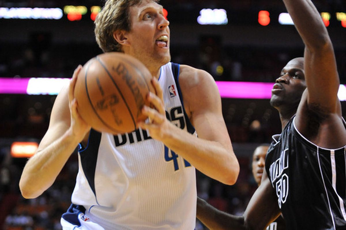 March 29, 2012; Miami, FL, USA; Dallas Mavericks power forward Dirk Nowitzki (41) drives to the basket as Miami Heat center Joel Anthony (50) defends in the first half at American Airlines Arena. Mandatory Credit: Steve Mitchell-US PRESSWIRE