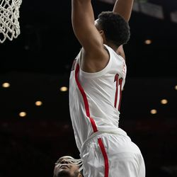 Ira Lee (11) jumps to two-hand slam during the tail end of the Arizona-University of Texas El Paso game in McKale Center on November 14 in Tucson, Ariz.