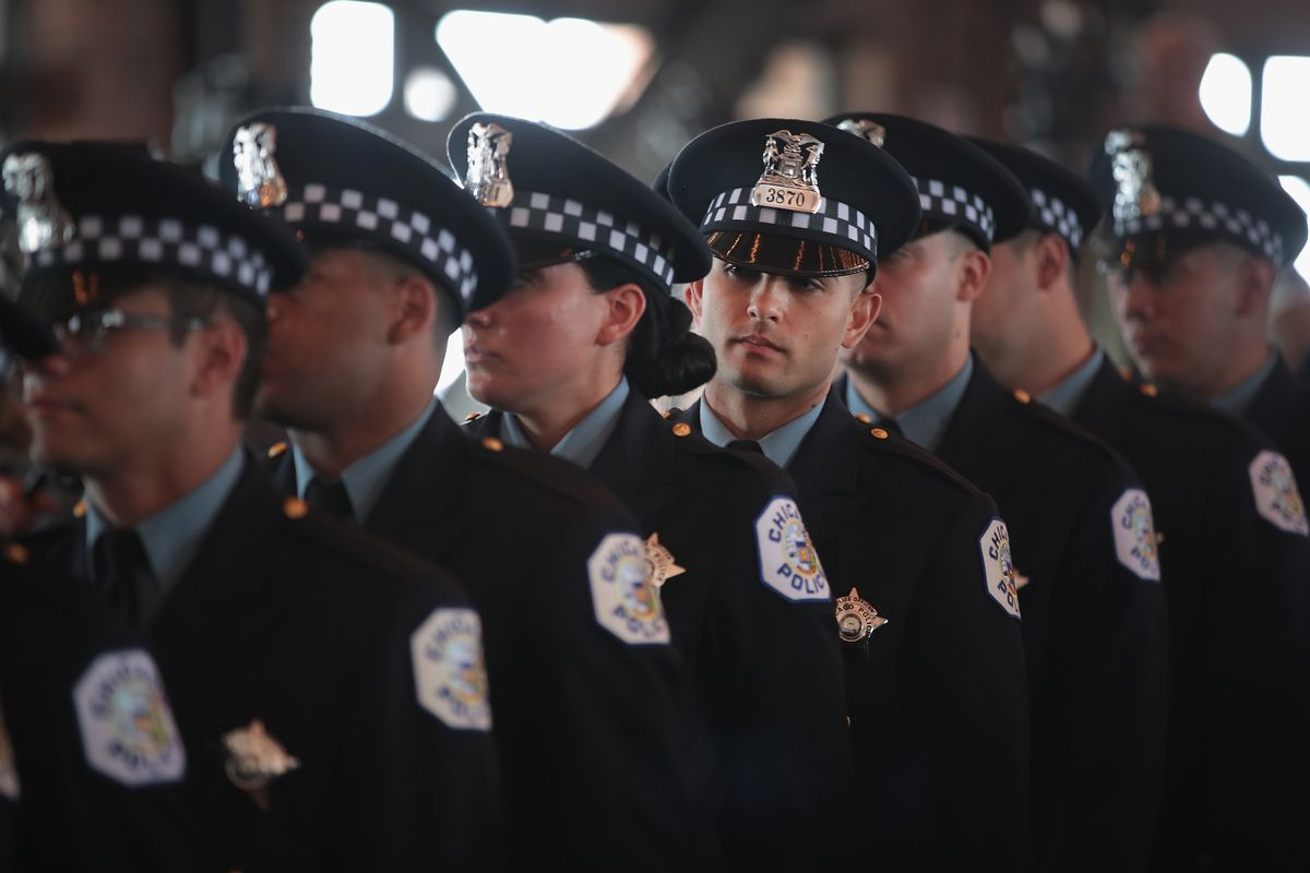 Chicago police officers attend a graduation and promotion ceremony in the Grand Ballroom on Navy Pier on June 15, 2017 in Chicago, Illinois.