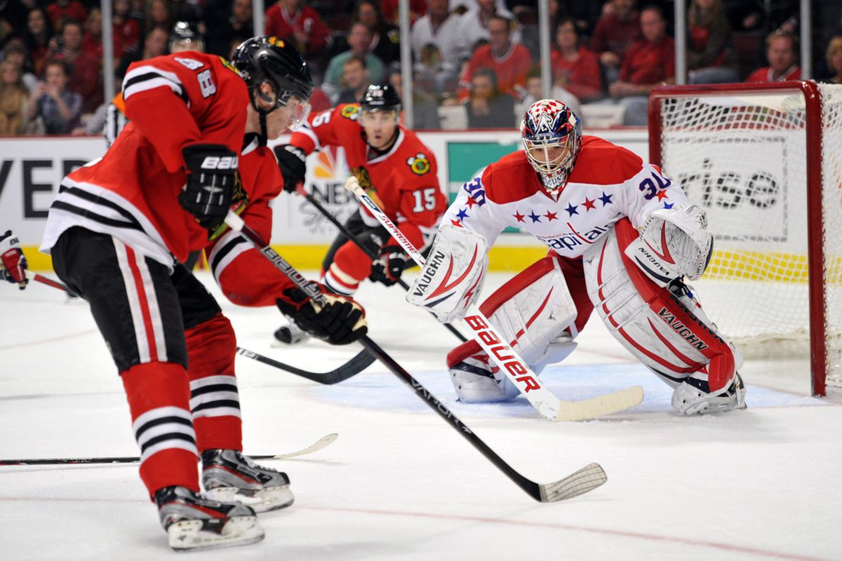 Mar 18, 2012; Chicago, IL, USA; Washington Capitals goalie Michal Neuvirth (30) watches Chicago Blackhawks right wing Patrick Kane (88) move the puck during the second period at the United Center. Mandatory Credit: Rob Grabowski-US PRESSWIRE