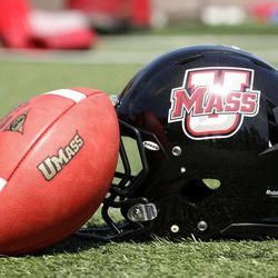 """In this photo taken Aug. 15, 2012 photo, the new """"UMass"""" logo for the University of Massachusetts is displayed during NCAA college football media day at McGuirk Stadium on the campus in Amherst, Mass.  Five programs """""""" Georgia State, Texas-San Antonio, South Alabama, Massachusetts and Texas State """""""" are at various stages in the two-year transition process to the top-tier Football Bowl Subdivision this season."""