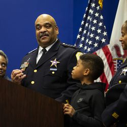 With Mayor Lori Lightfoot and his 10-year-old son looking on, Chicago Police Department Supt. Eddie Johnson gets emotional as he announces his retirement during a press conference at CPD headquarters, Thursday morning, Nov. 7, 2019.