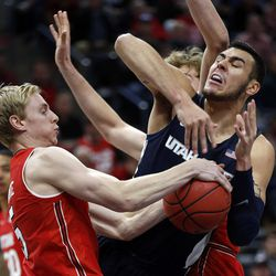 Utah State Aggies center Klay Stall is called for traveling as Utah Utes guard Parker Van Dyke pulls the ball away during NCAA basketball at Vivint Smart Home Arena in Salt Lake City on Saturday, Dec. 9, 2017.