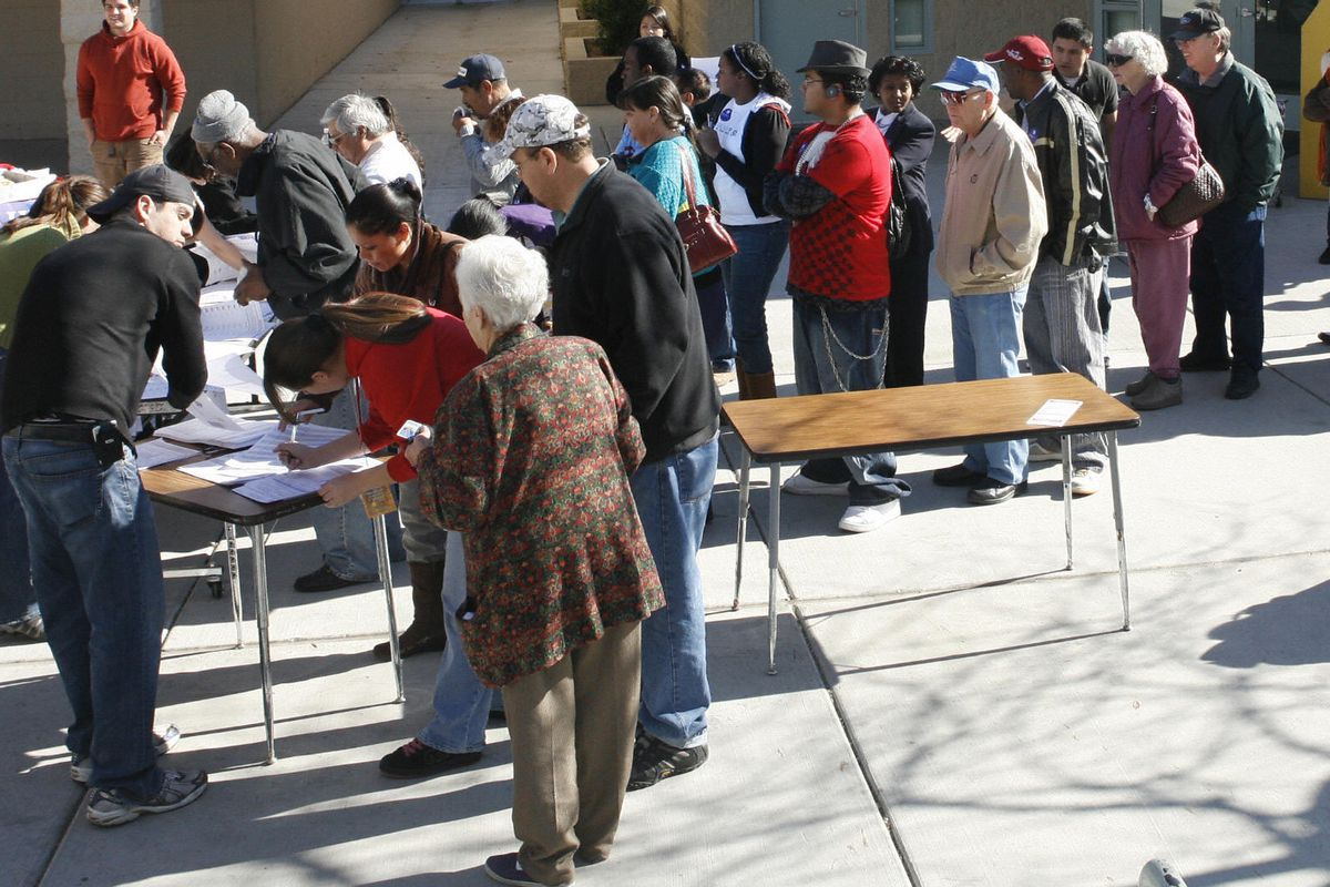 People line up to register for a caucus in the heavily Latino neighborhood of East Las Vegas in 2008.