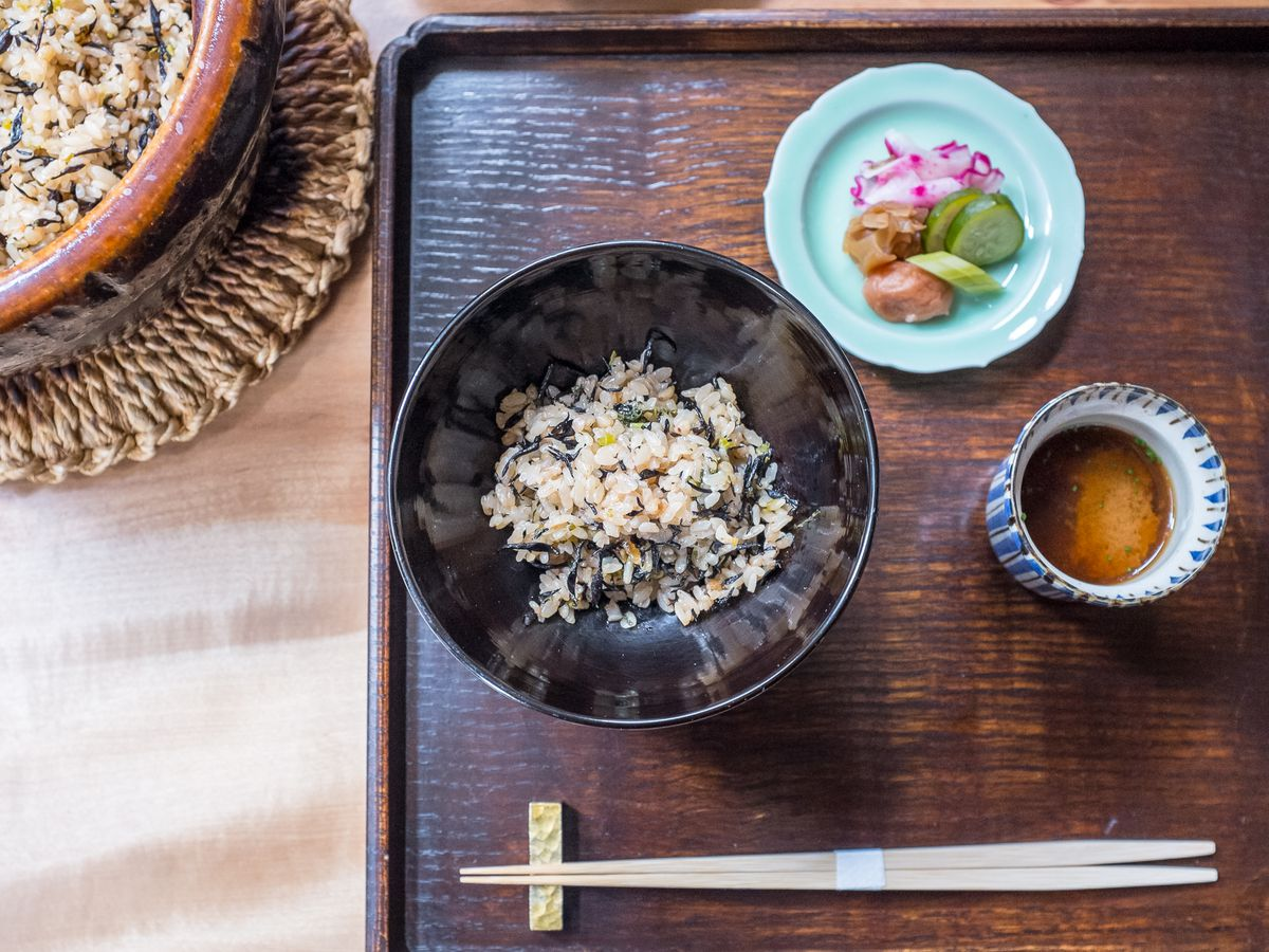 Rice and pickles on a tray with chopsticks at Kajitsu