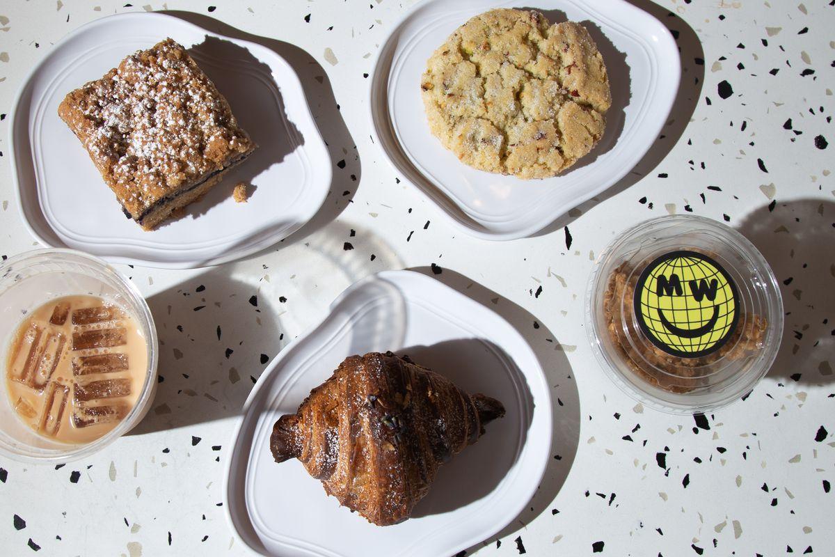 "Mina's World's cafe offerings, like vegan ""brookies"" from Crust Vegan Bakery and mango lassi parfait"