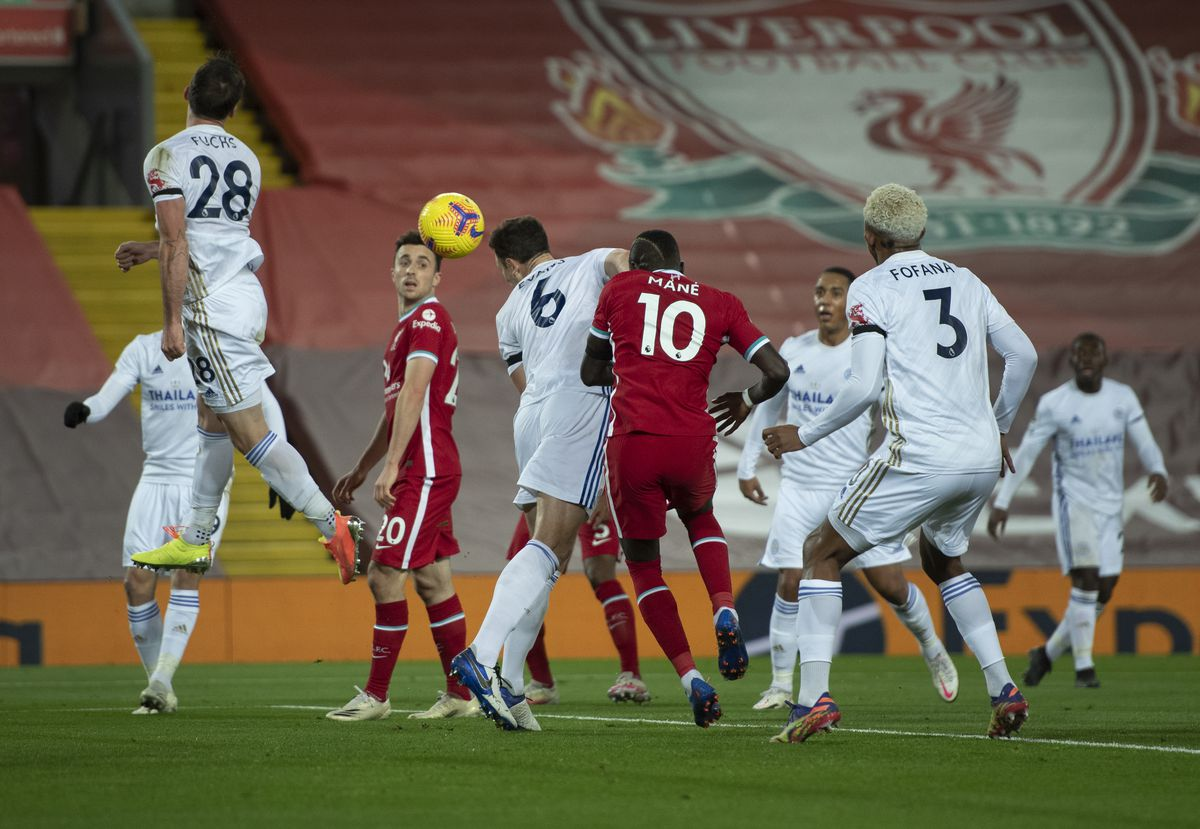 Jonny Evans of Leicester City scores an own goal during the Premier League match between Liverpool and Leicester City at Anfield on November 22, 2020